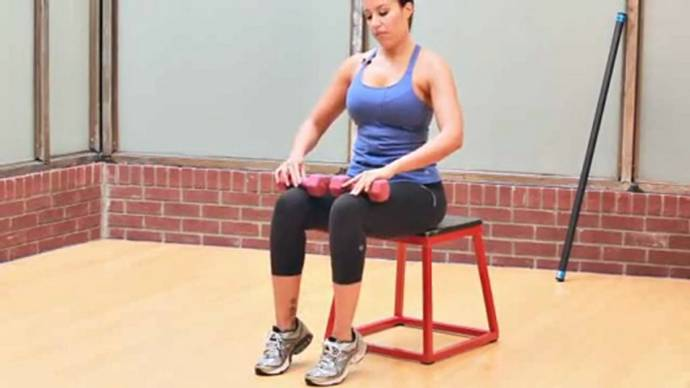 Sitting calf raise with dumbbell