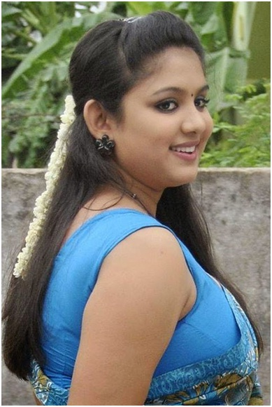 Kerala bridal open hairstyle with front puff