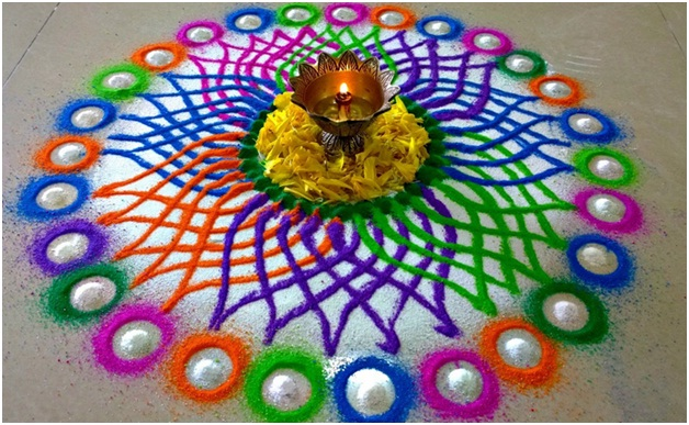 petal-shaped-multi-color-rangoli-in-white-base