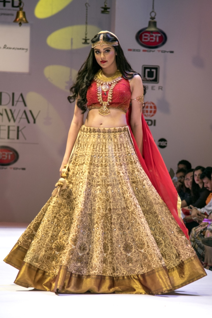 heavy-brocade-work-lahenga-with-halter-neck-blouse