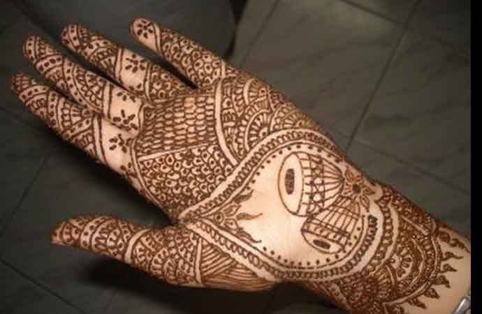 Unique bridal henna design with trumpet pair for palms