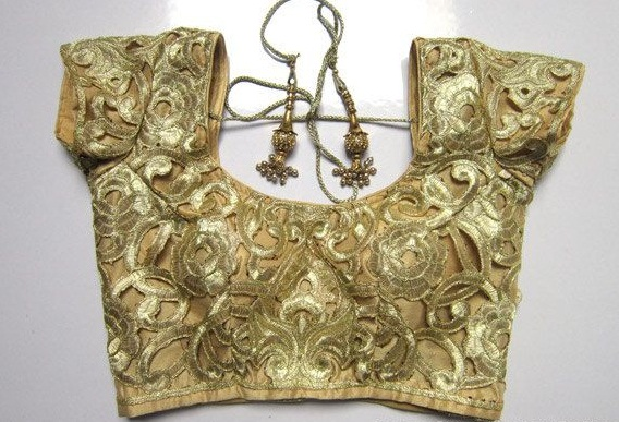 All over embroidered golden saree blouse