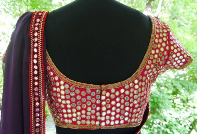 All over round mirror work blouse design