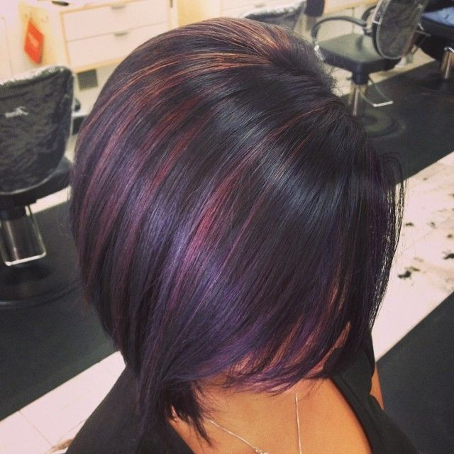 Artistic haircut with plum highlights