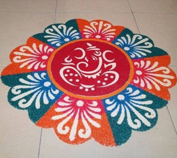 Beautiful floral patterned rangoli with Ganesh
