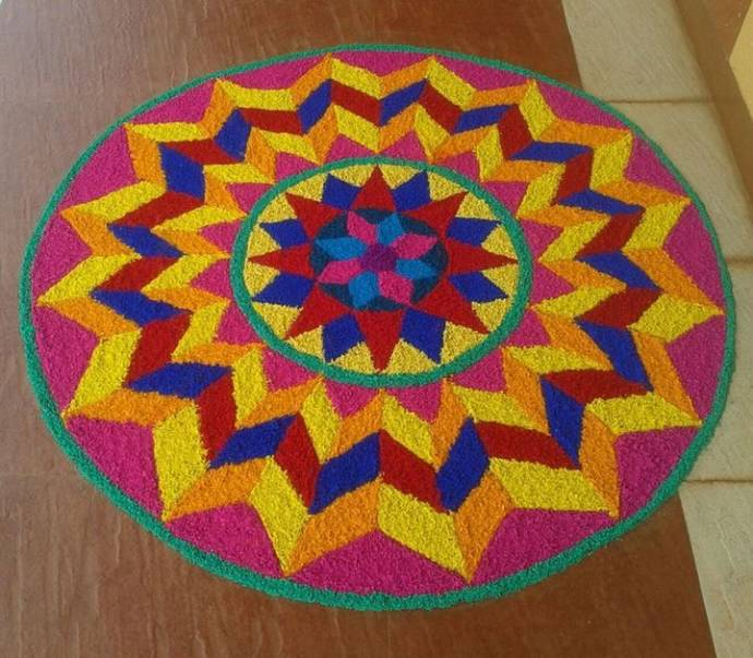 Big rangoli pattern with bright color combination