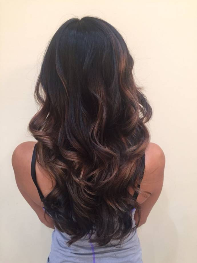Brown balayage on dark long hairs
