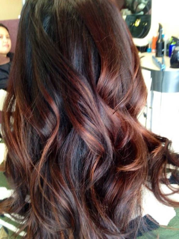 Brown red balayage on dark hair