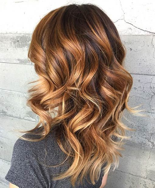 Caramel balayage highlighting on dark hairs