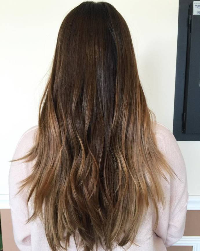 Caramel balayage on long dark hairs