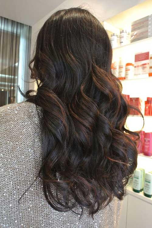 Caramel ribbon balayage on dark long hairs