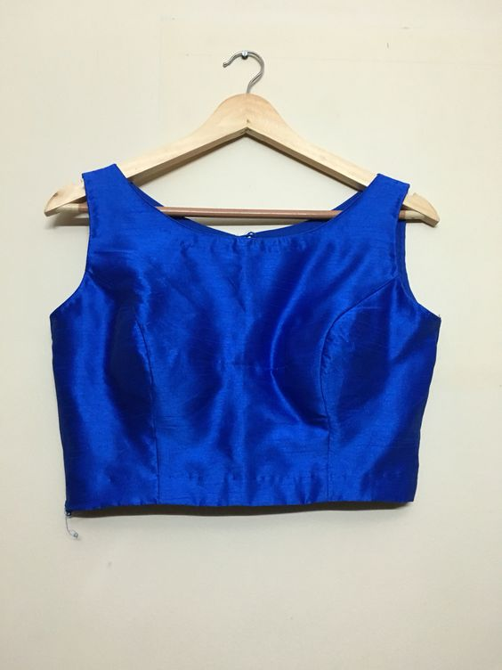 Electric blue boat neck solid sleeveless blouse