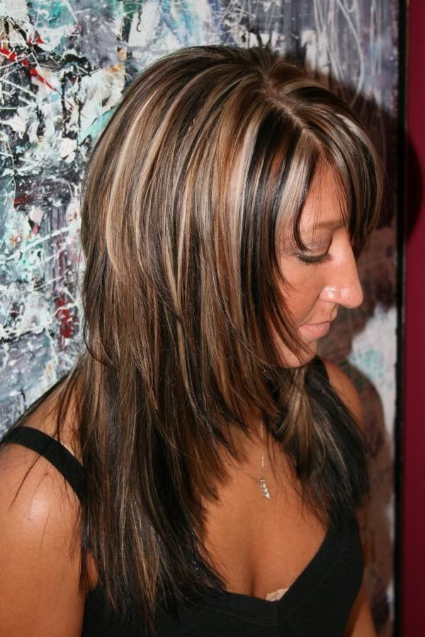 Frisky layered hairstyle with highlights and lowlights