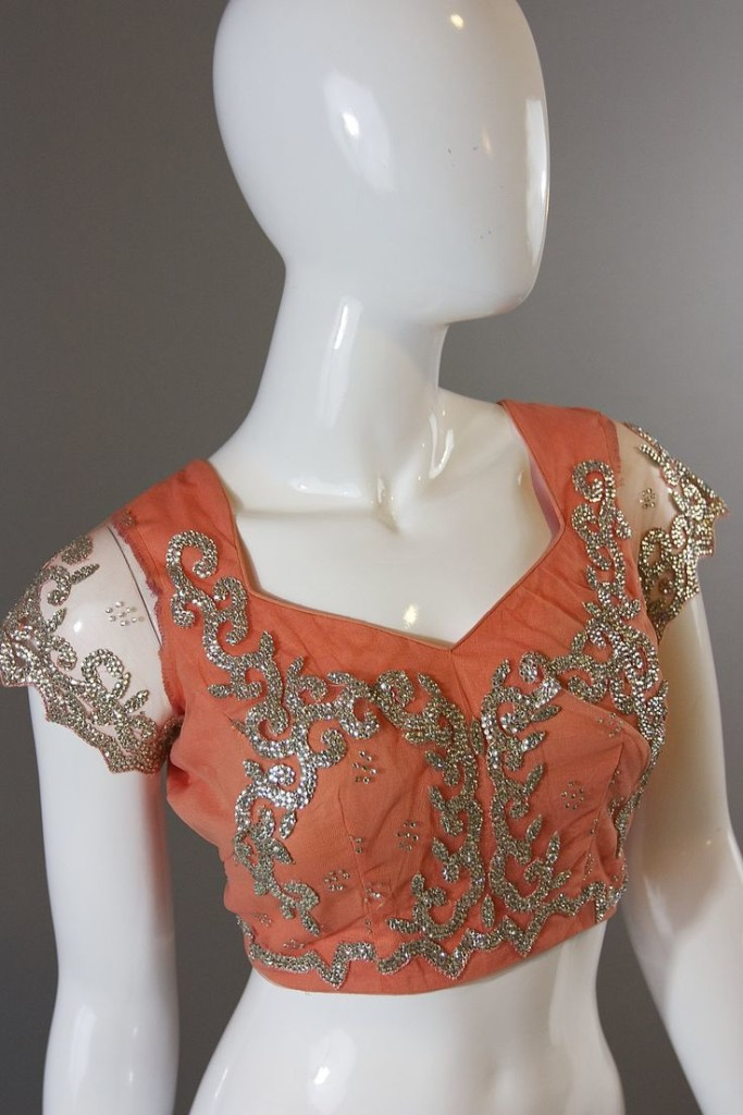 Gorgeous embellished blouse design with net sleeves