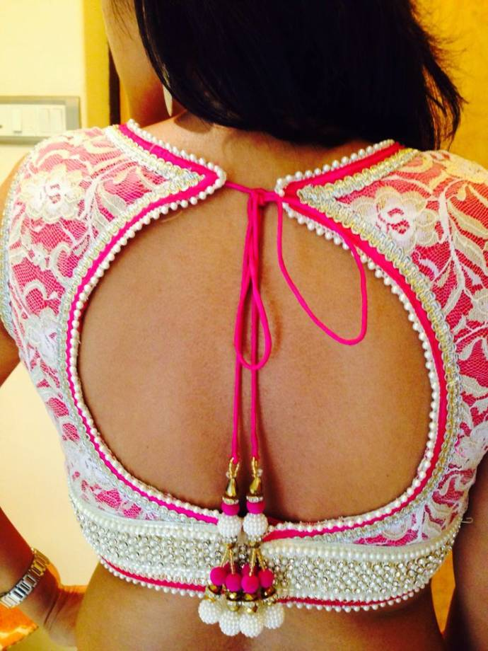 Low back blouse design with round shaped mid opening