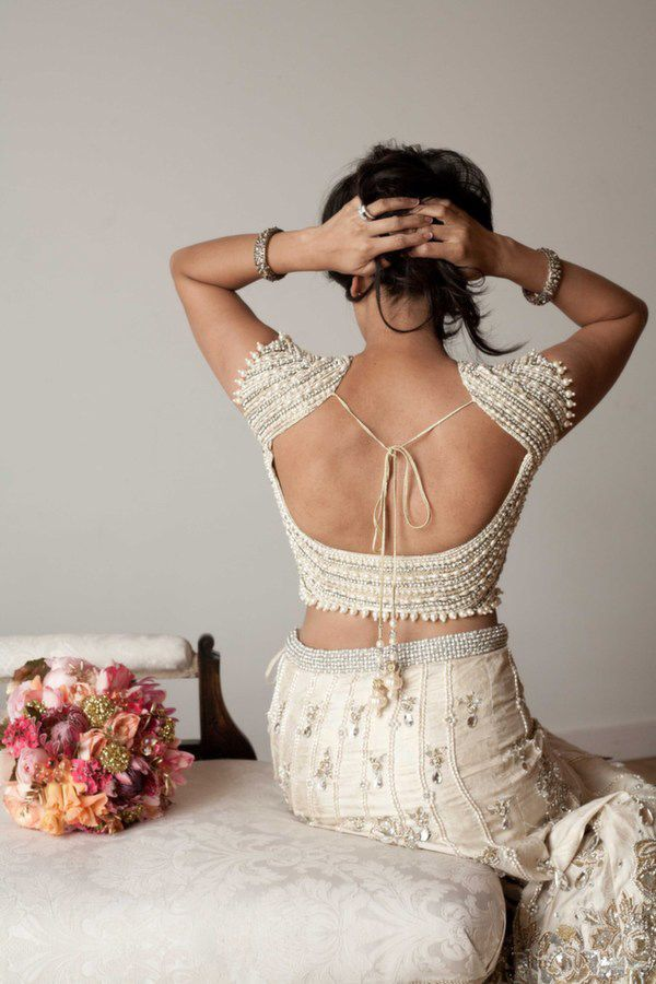 Low back blouse with intricate pearl decoration