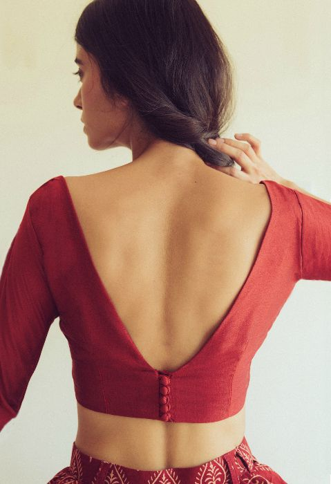 """Simple """"V"""" shaped low back blouse design with running buttons"""