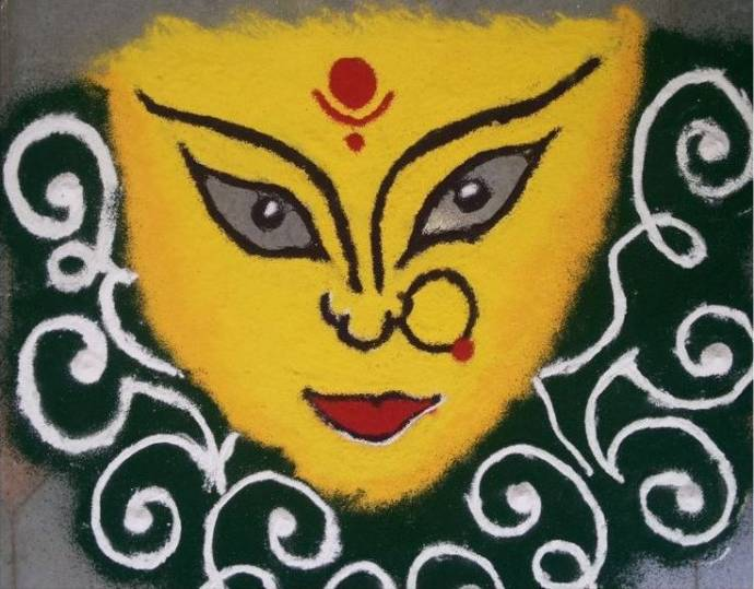 Simply face rangoli in yellow base