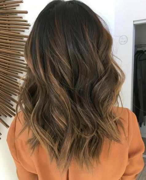Soft caramel balayge on black hair