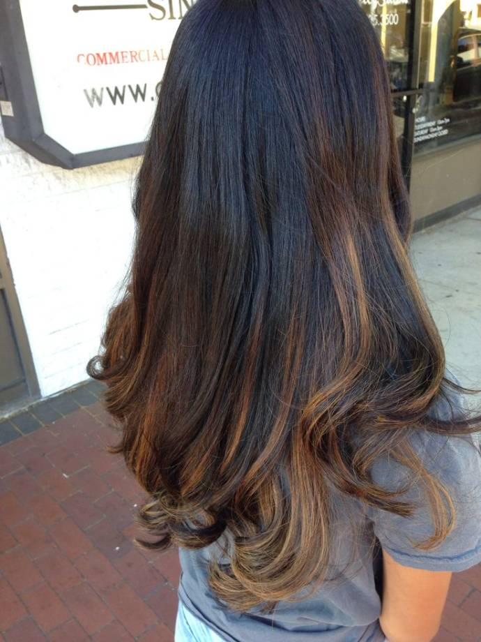Subtle balayage highlight on black hairs