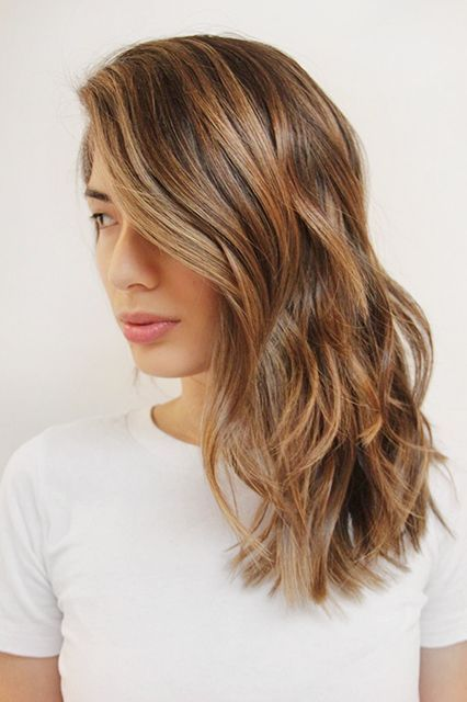 Warm brunette hair with subtle caramel highlights