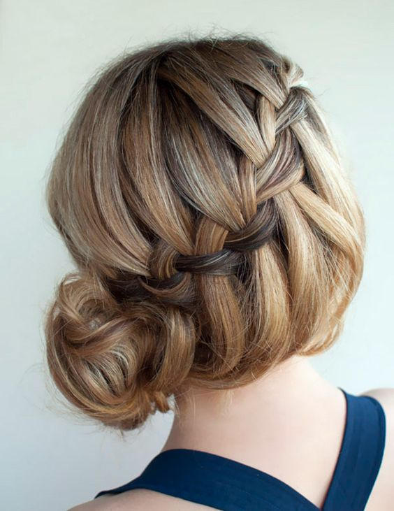Side-swept french braid and bun