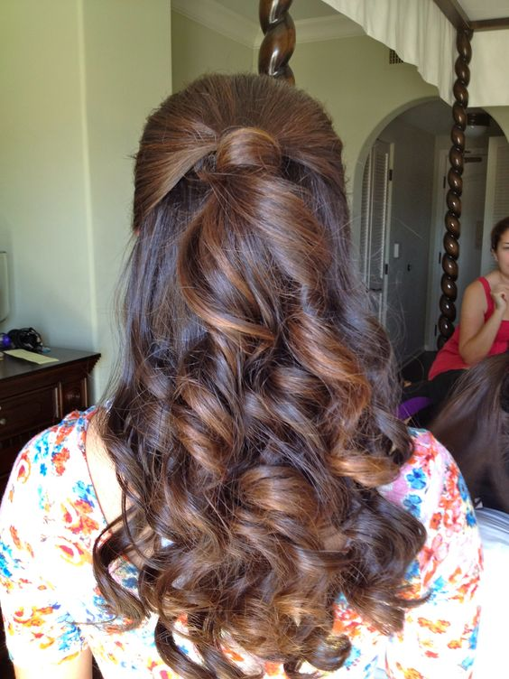 Twisted back bun with open hair