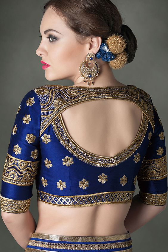 Royal blue heavy embroidery maggam blouse design