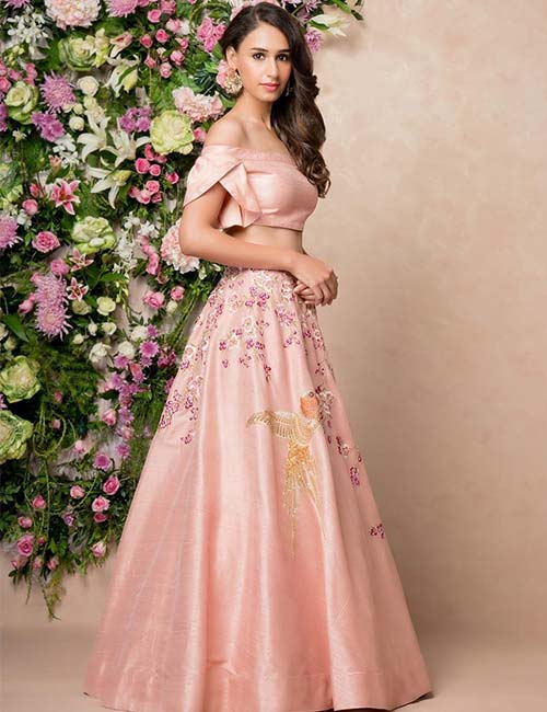 Pastel colored lehenga with off shoulder and flap sleeves
