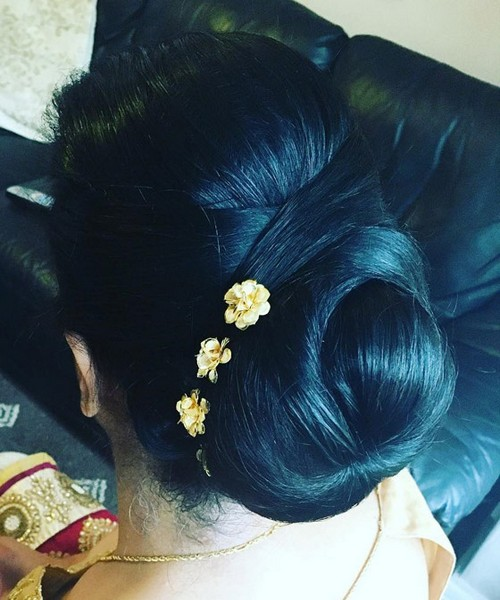 Criss-cross bun accented with flower