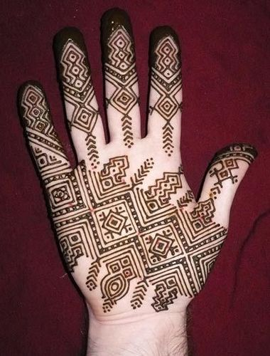 Geometric pattern henna on palms