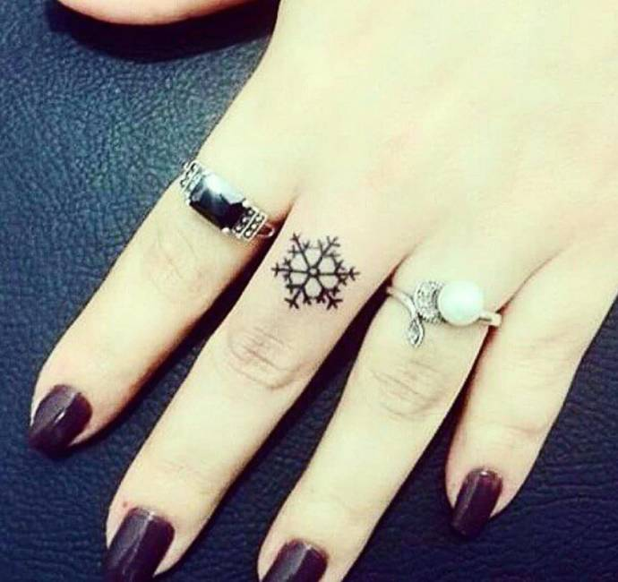 snowflake finger tattoos