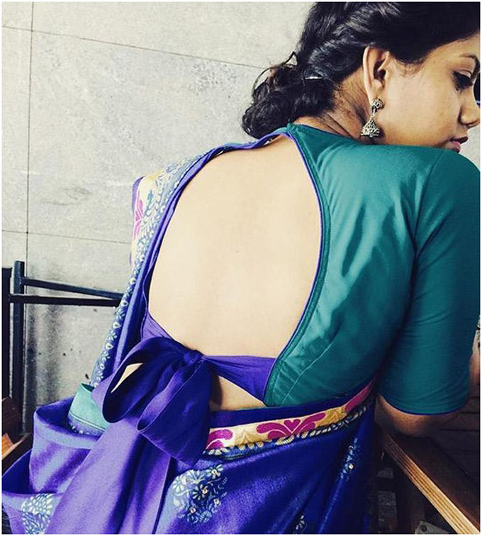Blouse with deep back and a bow for silk saree