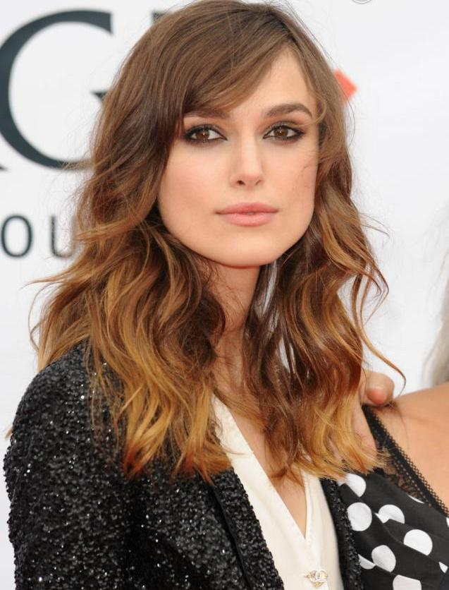 Wavy and curly side fringe hairstyle