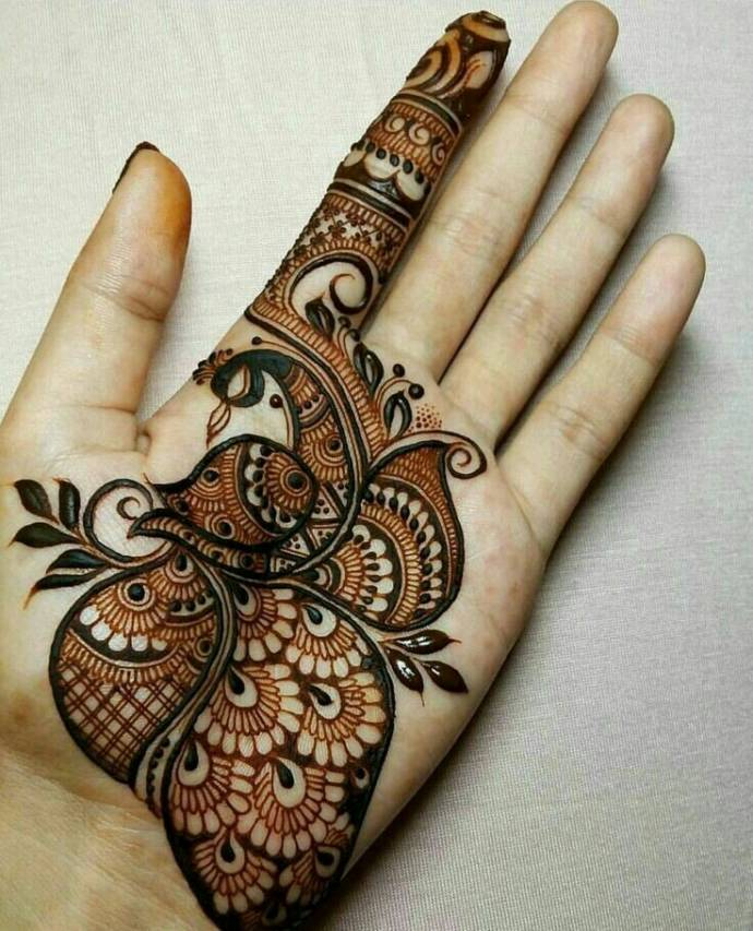 Peacock mehndi design for bride hand