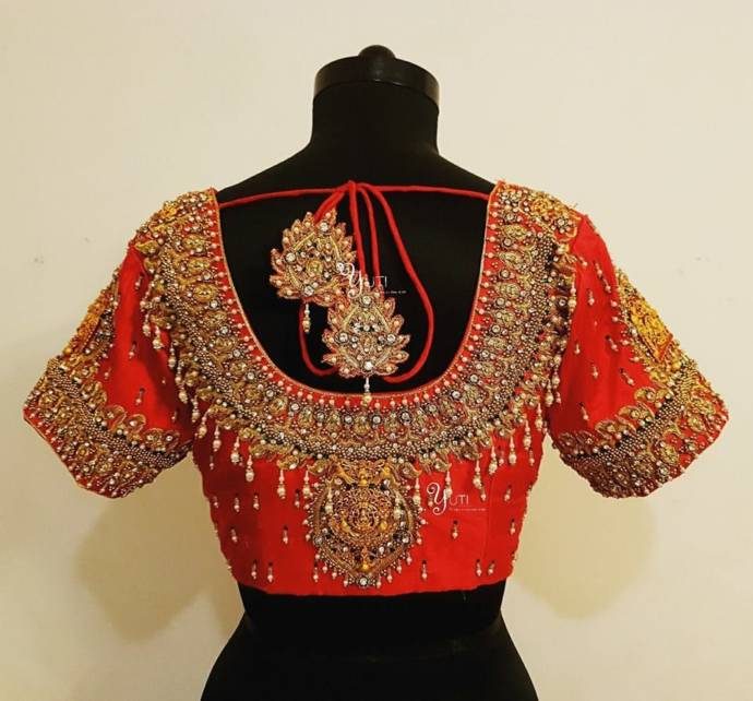 Wedding blouse design with covering maggam work