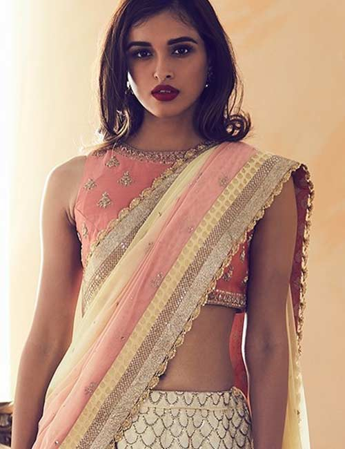 A heavy embroidered sleeveless blouse