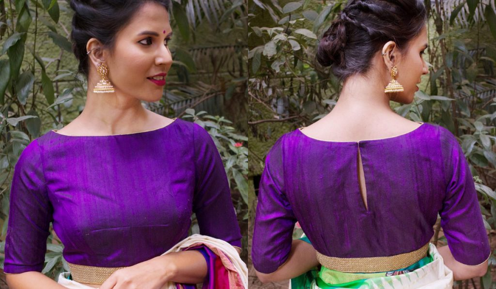 A plain boat neck blouse with a bordered waistline