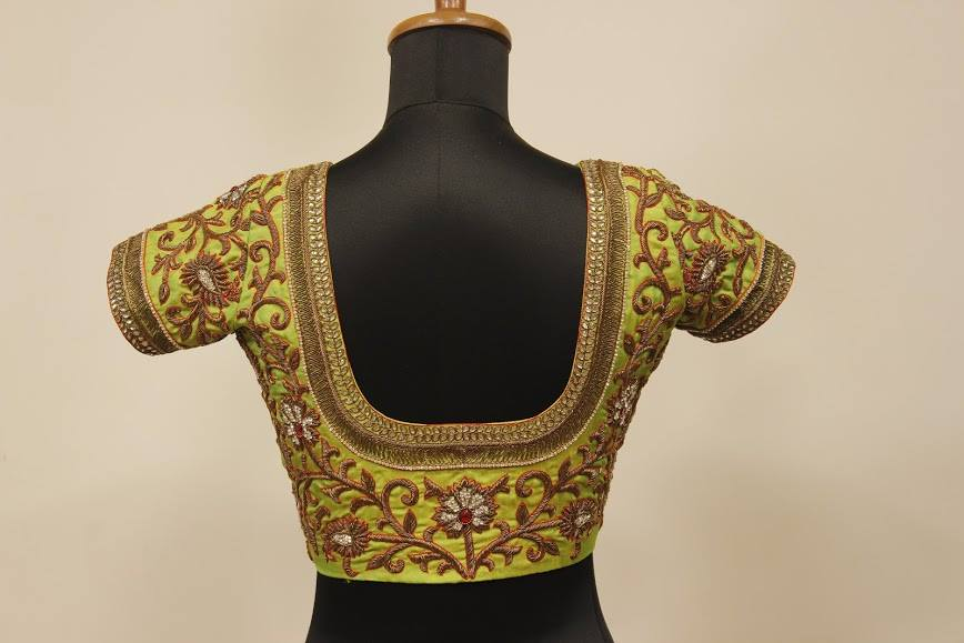 Pastel colored blouse with golden maggam work