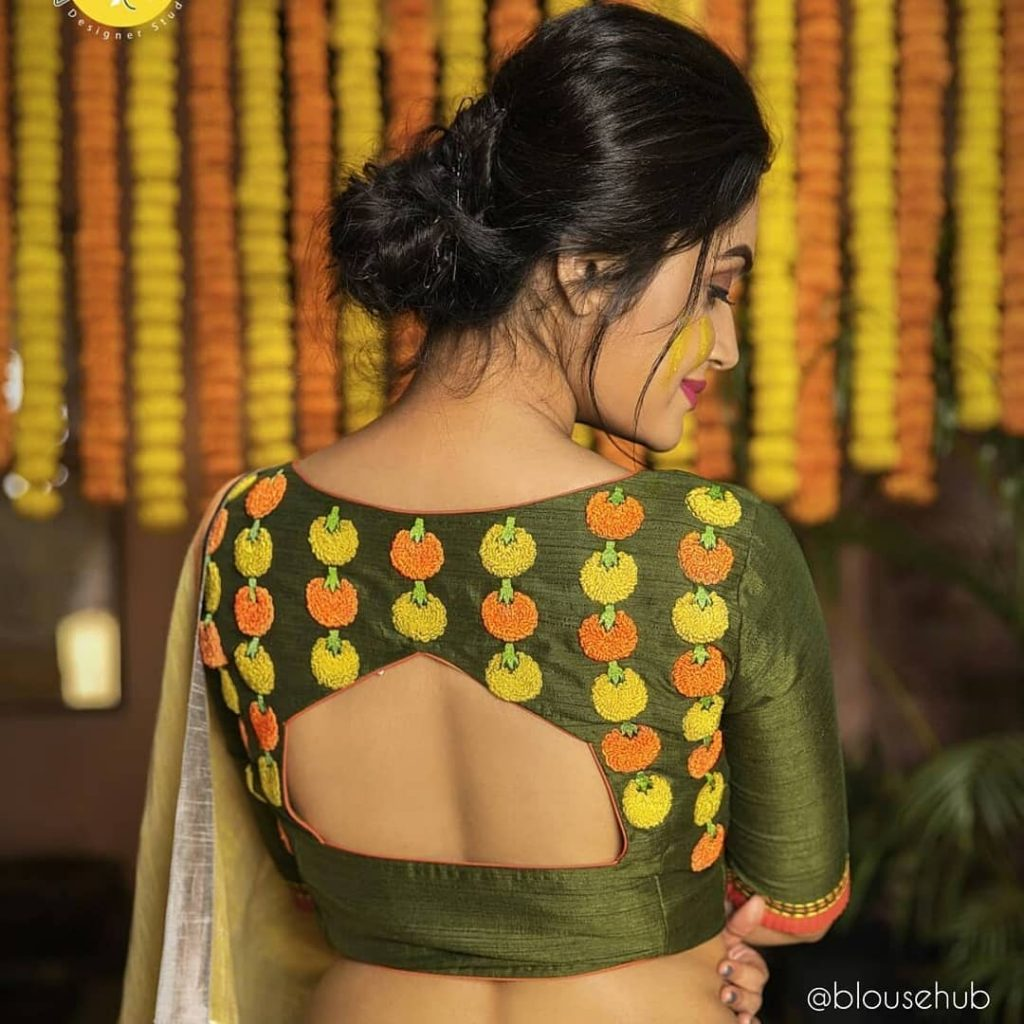 Quirky back design blouse with thread work