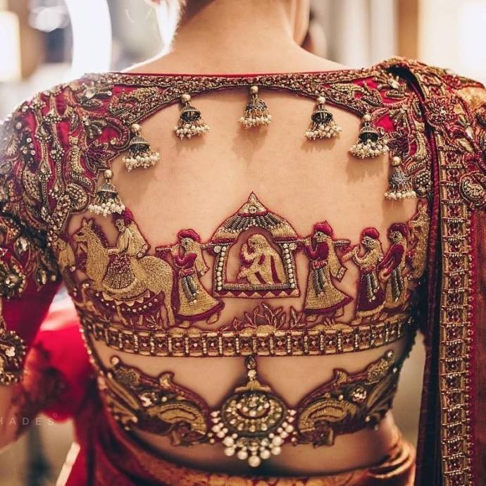Red embellished blouse with tassels and marriage scene embroidery