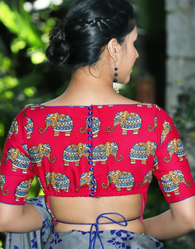 Stylish printed blouse design with full boat neck and strings at the back