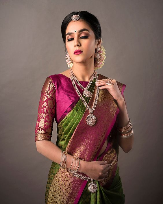 Traditional silk boat neck blouse with elegant sleeves
