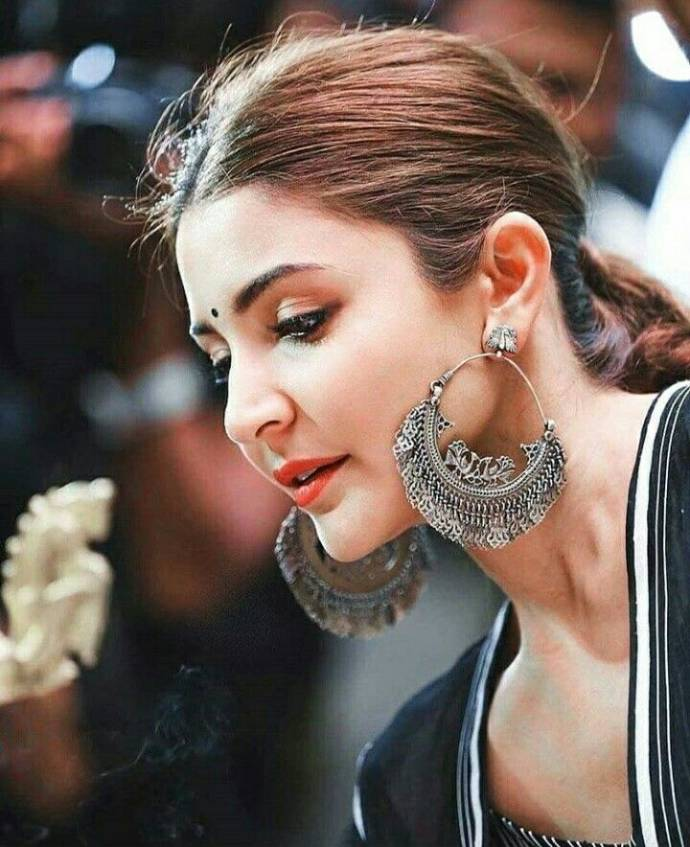 The oversized silver peacock hoops